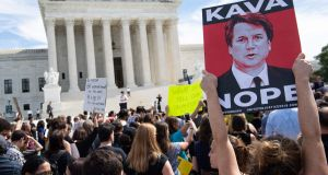 Demonstrators protest against Judge Brett Kavanaugh's nomination to the US supreme court due to sexual assault claims. Photograph:   Saul Loeb