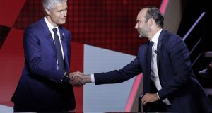 French prime minister Edouard Philippe (R) shakes hands with French right-wing Les Republicains  party president Laurent Wauquiez, ahead of the debate on  Thursday. Photograph: Geoffroy Van Der Hasselt