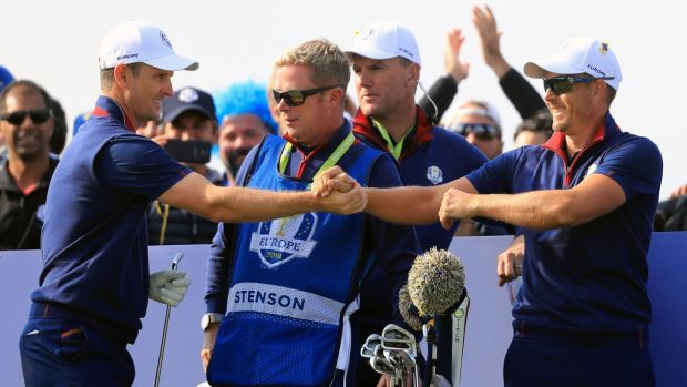 Team Europe's Justin Rose (left) celebrates his tee shot with Henrik Stenson on the 11th hole. Photograph: Gareth Fuller/PA Wire.
