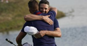 Europe's English golfer Justin Rose (R) and Europe's Swedish golfer Henrik Stenson celebrate their victory. Photograph: Getty Images