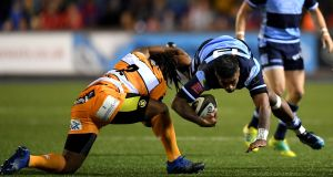Cardiff's Rey Lee-Loo is tackled by Joseph Dweba of the Cheetahs during the  Guinness Pro14 game at Cardiff Arms Park. Photograph: Alex Davidson/Inpho