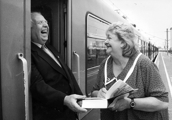 Maeve Binchy is seen chatting to a Dart driver, Michael Flanagan,at Dun Laoghaire station during the launch of her 1994 book, The Glass Lake. Photograph: Pat Langan/The Irish Times