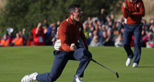 Rory McIlroy celebrates a putt on the 5th green. Photograph: David Davies/PA Wire.