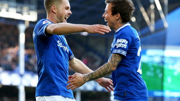 Gylfi Sigurdsson of Everton celebrates with Bernard of Everton after scoring the third goal. Photograph: Alex Livesey/Getty Images