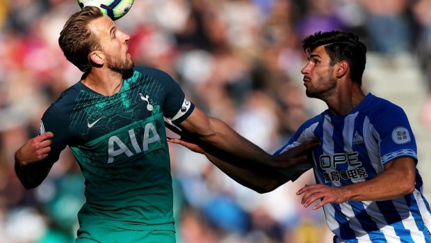 Harry Kane of Tottenham Hotspur heads the ball under pressure from Christopher Schindler. Photograph: Alex Morton/Getty Images