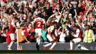 Arsenal's Mesut Ozil (left) celebrates with his team-mates after scoring his side's second goal. Photograph: Yui Mok/PA Wire.