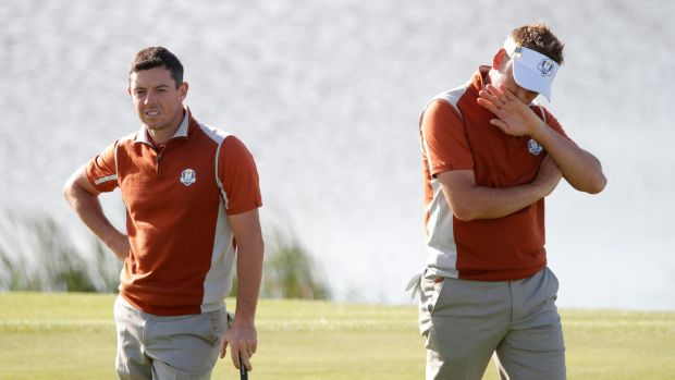 Rory McIlroy and Ian Poulter during their foursomes match against Justin Thomas and Jordan Spieth. Photograph: Charles Platiau/Reuters