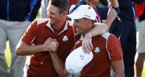Justin Rose  and Henrik Stenson  celebrate during the afternoon foursomes match against Dustin Johnson and Brooks Koepka. Photograph:  Christian Petersen/Getty Images