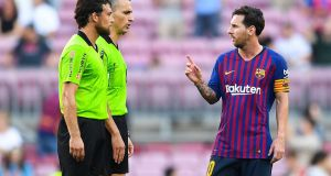 Lionel Messi of FC Barcelona argues with the referee Jaime Latre at the end of the   match. Photograph: David Ramos/Getty Images