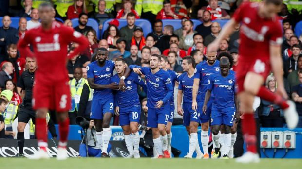 Chelsea's Eden Hazard celebrates scoring with his team-mates in the Premier League game at Stamford Bridge. Photograph: David Klein/Reuters
