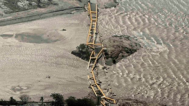 An aerial view shows a bridge damaged by an earthquake and tsunami in Palu, Central Sulawesi, Indonesia. Photograph: Antara Foto/Muhammad Adimaja via Reuters