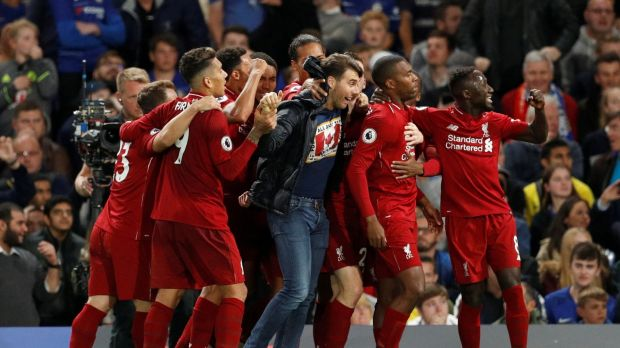 A supporter joins in as Liverpool's Daniel Sturridge celebrates scoring the equalising goal with his team-mates at Stamford Bridge. Photograph: John Sibley/Action Images via Reuters