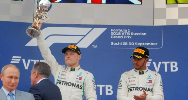 Valtteri Bottas holds the winner's trophy aloft after obeying Mercedes team orders to let Lewis Hamilton win the Russian Grand Prix. Photograph: Maxim Shemetov/Reuters