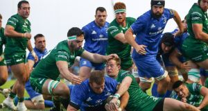 Leinster's Sean Cronin scores his side's second try despite the efforts of Connacht's Paul Boyle and Kieran Marmion at the Sportsground in Galway. Photograph: James Crombie/Inpho
