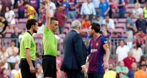 Barcelona's Lionel Messi is shown a yellow card at the end of the  match against  Athletic Club Bilbao at the Camp Nou stadium in Barcelona. Photograph:  Getty Images