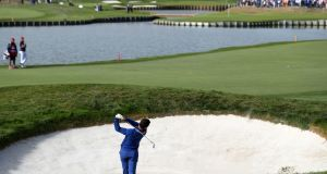 Rory McIlroy plays his second shot out of a bunker on the  18th during the singles Ryder Cup defeat to Justin Thomas   at Le Golf National, Saint-Quentin-en-Yvelines, Paris. Photograph: David Davies/PA Wire.