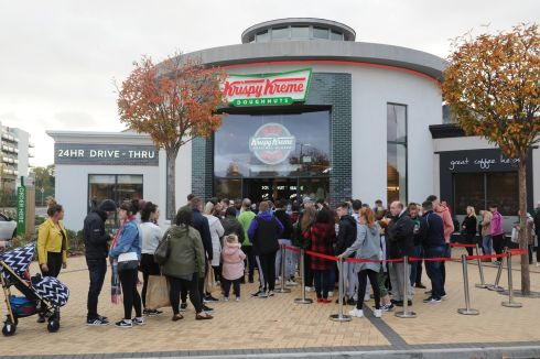 People queue outside the newly opened Krispy Kreme outlet at Blanchardstown Shopping Center on Sunday, four days after the outlet's official opening. Photograph: Aidan Crawley/The Irish Times
