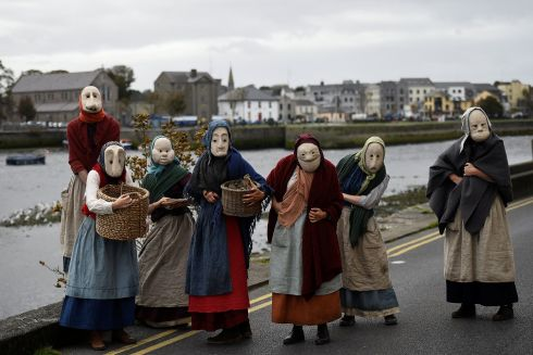 FISHING PLAY: Actors participate in a street performance called 'The Fisherwives', by Bru Theatre group, representing part of the fishing community from 100 years ago, at the Spanish Arch in Galway on September 30th, 2018. Photograph: Clodagh Kilcoyne/Reuters