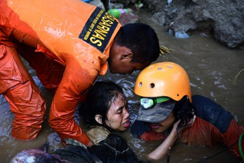 RESCUE: Indonesian rescuers try to free a 15-year-old earthquake survivor, Nurul Istikhomah from the flooded ruins of a collapsed house in Palu, Central Sulawesi, Indonesia on September 30th, 2018. Istikhamah has been trapped under water for two days. Authorities said on September 30th, that at least 832 people have died as a result of a series of powerful earthquakes that hit Central Sulawesi and triggered a tsunami on September 28th. Photograph: Arimacs Wilander/EPA