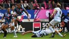 Stade Français' Paris French centre Gael Fickou eludes Racing 92 number eight Antonie Claassen during the French Top 14 clash at Jean-Bouin Stadium in Paris. Photograph: Anne-Christine Poujoulat/AFP/Getty