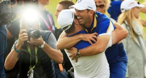 Sergio Garcia  and Jon Rahm  celebrate Europe's Ryder Cup win in Paris. Photograph:  Mike Ehrmann/Getty Images