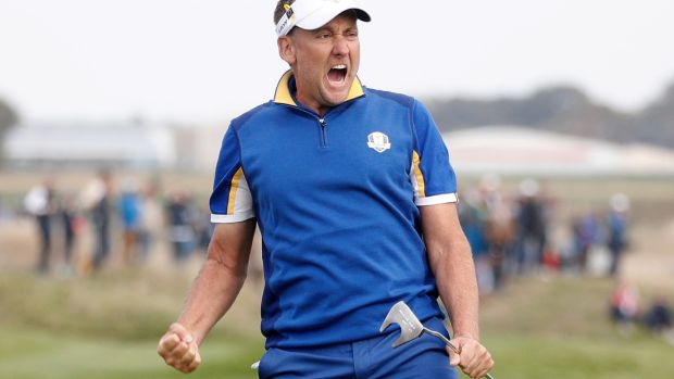 Ian Poulter reacts to his putt on the 14th green of his match against Dustin Johnson during the Ryder Cup singles on Sunday. Photograph: Ian Langsdon/EPA