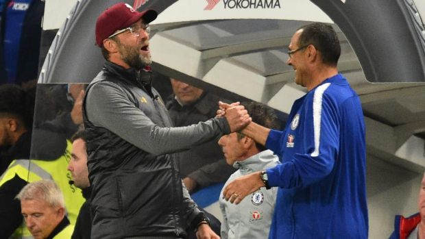 Liverpool manager Jurgen Klopp and Chelsea boss Maurizio Sarri embrace after their Premier League draw on Saturday. Photo: Getty Images