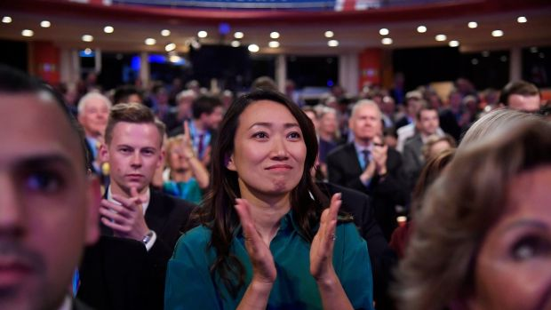 The wife of Britain's foreign secretary, Jeremy Hunt, Lucia Guo, reacts after her husband's address. Photograph: Toby Melville/Reuters