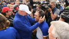 Francesco Molinari of Europe celebrates winning the Ryder Cup with captain Thomas Bjorn at Le Golf National in Paris, France. Photo: Ross Kinnaird/Getty Images