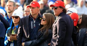Jordan Spieth with Annie Verret and Phil Mickelson (right) after Europe won the Ryder Cup in Paris. Photo: Gareth Fuller/PA
