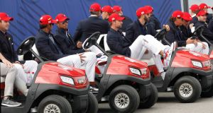 Team USA players sit in golf buggies after losing the Ryder Cup on Sunday. Photograph: Charles Platiau/Reuters