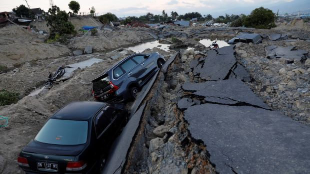 Cars are trapped in sinking ground after an earthquake hit at Balaroa sub-district in Palu, Sulawesi Island on Monday. Photograph: Beawiharta/Reuters