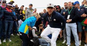 US golfer Brooks Koepka reacts after his tee shot hit a spectator during the Ryder Cup at Le Golf National. Photograph: Getty Images