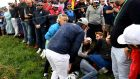 US golfer Brooks Koepka reacts next to an injured spectator during the Ryder Cup. Photograph: Getty Images