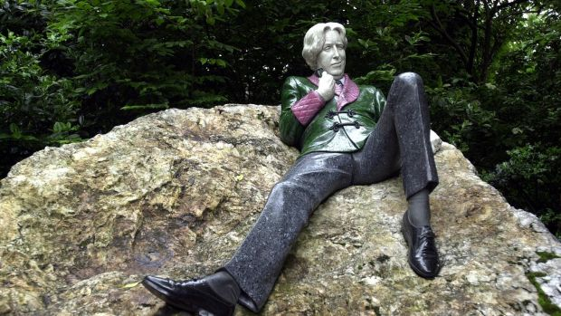The statue of Oscar Wilde lounges on a rock across the road from where he grew up at 1 Merrion sqaure, Dublin. Photograph: Eric Luke