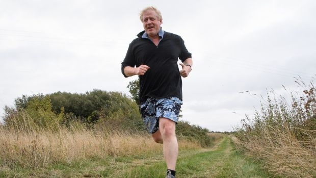 Boris Johnson runs near his home on Tuesday ahead of his speech at the Conservative Party Conference. Photograph: Getty