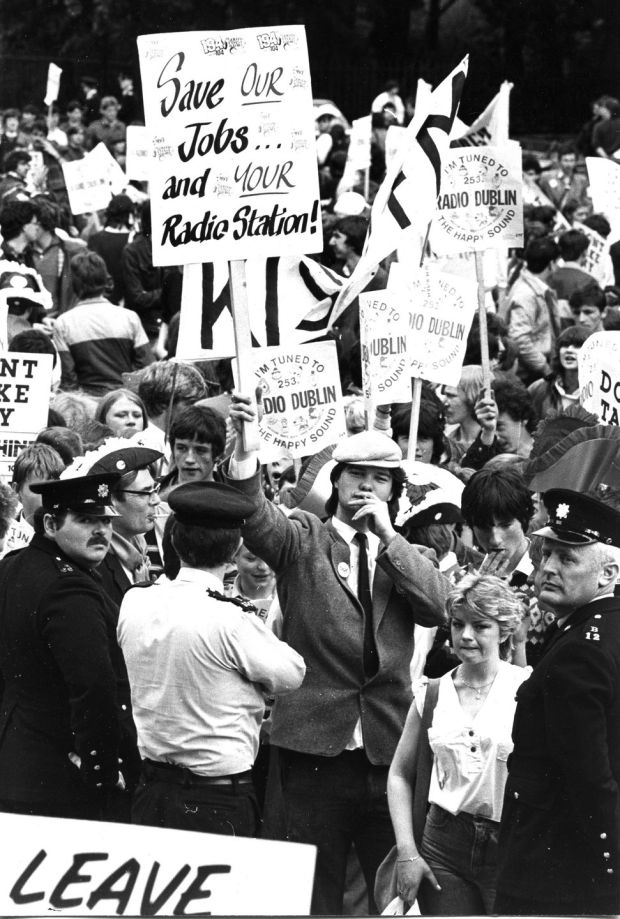 Pirate radio fans march in protest following the raid on Radio Nova, Kiss FM and Sunshine arriving at Government Buildings, May 1983. Photograph: Peter Thursfield