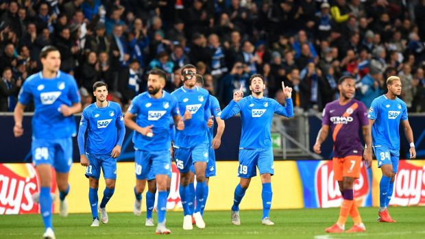 Hoffenheim celebrate Ishak Belfodil's early opener against Manchester City. Photograph: Thomas Kienzle/AFP/Getty