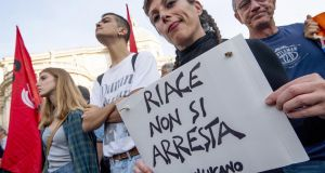 Demonstrators protest  against the arrest of Riace mayor Domenico  Lucano, in Rome, Italy. Photograph:  Claudio Peri/EPA