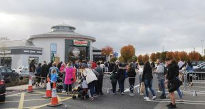 People queue outside the newly opened Krispy Kreme outlet at Blanchardstown Shopping Centre last weekend. Photograph: Aidan Crawley