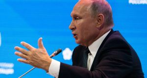 Russian president Vladimir Putin gestures while answering questions at the Russian Energy Week International Forum in Moscow. Photograph: AP Photo/Alexander Zemlianichenko/Pool