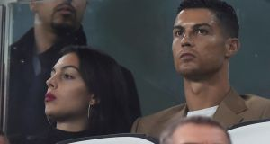 Ronaldo and his  girlfriend Georgina Rodriguez sit in the stand at the Allianz Stadium in Turin during the Champions League game between Juventus and Young Boys on Tuesday night. Photograph: Massimo Pinca/Reuters