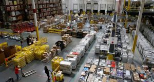 Amazon's pay rise helps to address growing discontent at working conditions in its network of logistics warehouses. Photograph: AP