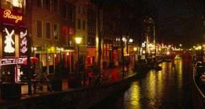 The red light district in Amsterdam: 'Sometime it is as simple as tourists not realising that real people live here.' Photograph: Getty Images