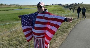 A spectator wears clothing in the colours of the US flag during a practice session ahead of the 42nd Ryder Cup at Le Golf National Course south-west of Paris on September 26th. Photograph: Lionel Bonaventure/AFP/Getty Images