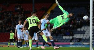 Sheffield United's Billy Sharp scores his and his side's second  goal past Blackburn Rovers goalkeeper David Raya during the Sky Bet Championship match at Ewood Park. Photograph: Martin Rickett/PA Wire