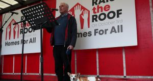 Fr Peter McVerry with his dog Tiny at the  Raise the Roof housing rights protest outside Leinster House. Photograph:  Brian Lawless/PA Wire