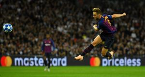 Barcelona's Ivan Rakitic volleys home their second goal in the  Champions League  Group B match against  Tottenham Hotspur at Wembley Stadium. Photograph: Dylan Martinez/Reuters