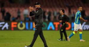 Jurgen Klopp thanks the Liverpool fans who travelled to Naples. Photograph: Catherine Ivill/Getty Images