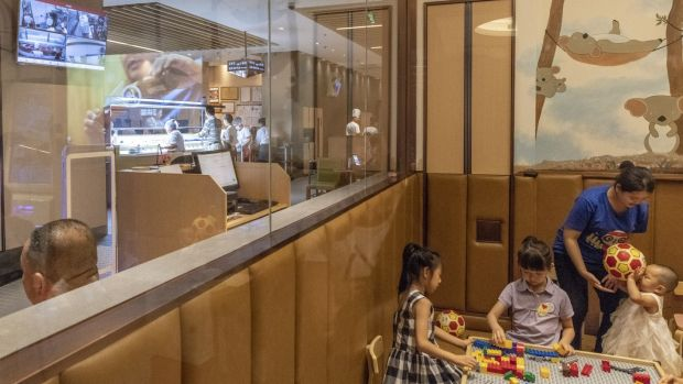 A children's play area at a Haidilao restaurant in Beijing. Photograph: Gilles Sabrié/ The New York Times